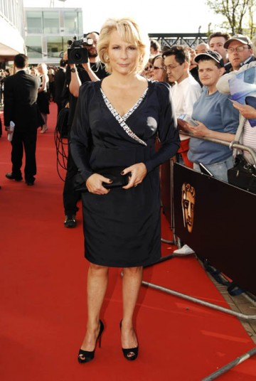 Jennifer Saunders wore a navy Betty Jackson dress to collect her Academy fellowship with comedy partner Dawn French (BAFTA / Richard Kendal).