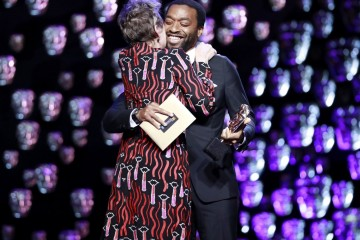 Leading Actress winner Frances McDormand hugs Chiwetel Ejiofor