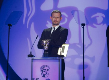 The British Actor, perhaps best known for his role as Nick Tilsley in Coronation Street presents the Visual Effects Award. (Pic: BAFTA/Jamie Simonds)