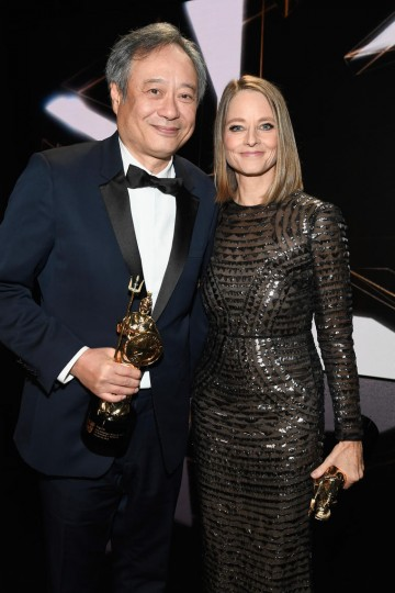 Honorees Ang Lee and Jodie Foster pose with their Britannia Awards onstage.