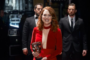 Leading Actress winner Julianne Moore poses backstage at London's Royal Opera House.