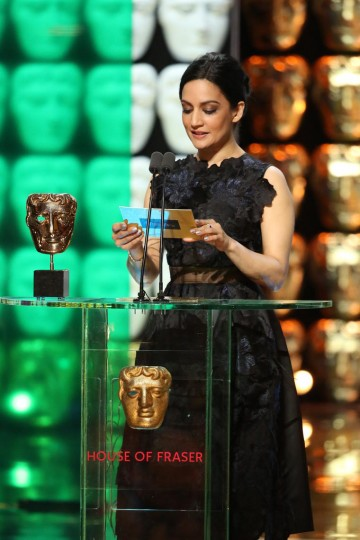 Archie Panjabi presents the award for Supporting Actor