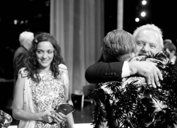 Fellowship recipient Anthony Hopkins and Actress winner Marion Cotillard congratulate Tilda Swinton on her Supporting Actress BAFTA (pic: Greg Williams / Art + Commerce).
