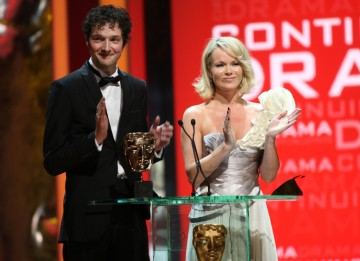 Britain's Got Talent judge Amanda Holden and comedien Chris Addison present the BAFTA for Continuing Drama. (BAFTA/Steve Butler)