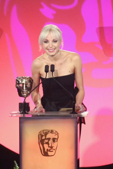 Helen George presents the award for Costume Design at the British Academy Television Craft Awards in 2015