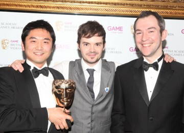 Presenter Barney Harwood with the winners behind the spectacular collection of mini games that triumphed in the Family category. (Pic: BAFTA/Steve Butler)