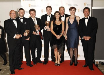 The Production team of Embarassing Bodies Online with citation readers John Torode and Gregg Wallace pose for the photogrpahers after winning the Interactivity Award (BAFTA / Richard Kendal).