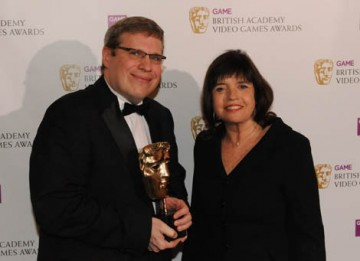 Barry Caudill celebrates his win in the Strategy category for Sid Meier's Civilization Revolution. The mask was presented by Barbara Follett MP (BAFTA / James Kennedy).