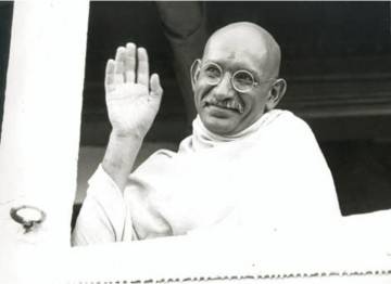 Mahatma Gandhi (Ben Kingsley) waves farewell as the steamship taking him to London gets underway in Bombay.