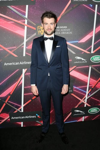 British comedian Jack Whitehall makes an appearance on the red carpet ahead of the ceremony.