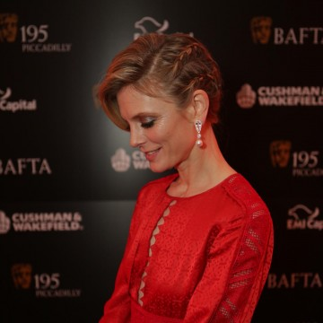Demure profile shot of actress Emilia Fox who was dressed by BAFTA partner Yoko London