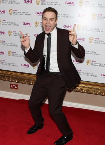 X Factor finalist Olly Murs marks his arrival on the Video Game Awards red carpet.