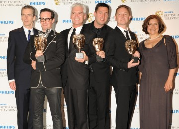Peter Capaldi and Rebecca Front presented The Cube team, including Adam Adler, Nathan Eastwood, Andrew Newman and Phillip Schofield, with the BAFTA for Entertainment Programme. (Pic: BAFTA/Richard Kendal)