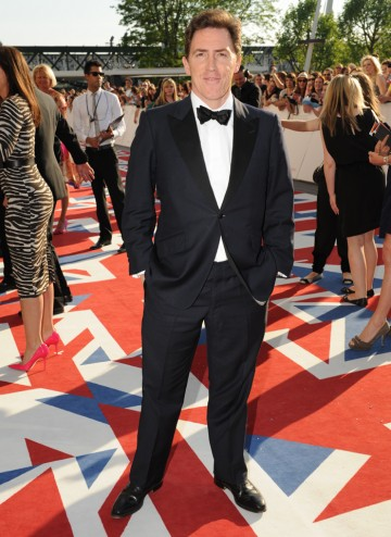 The Welsh comic actor and star of The Trip and Gavin and Stacey smiles for the camera. Rob Brydon wear a suit by Richard James.