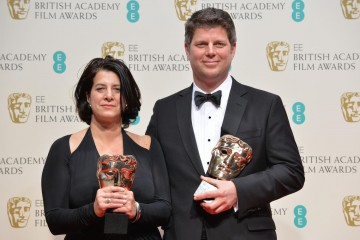 Production Design - The Grand Budapest Hotel: Anna Pinnock and Adam Stockausen pose with their awards
