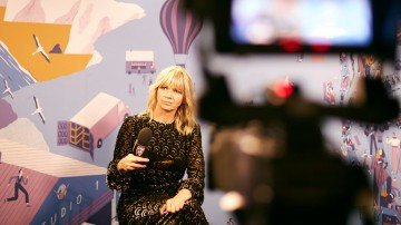 Zoe Ball prepares to interview the winners as they come off stage