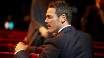 Luke Evans in his seat in the Auditorium of London's Royal Opera House.