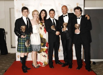 Jamie Isaacs, Gareth Malone, Henry Beney and Rob McCabe celebrate their win in the Features category for The Choir: Boys Don't Sing (BAFTA/ Richard Kendal).