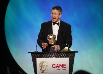 Keith Ramsdale returns to the stage for a second time in the evening to pick up the Sports category award for FIFA 10 (BAFTA/Brian Ritchie)