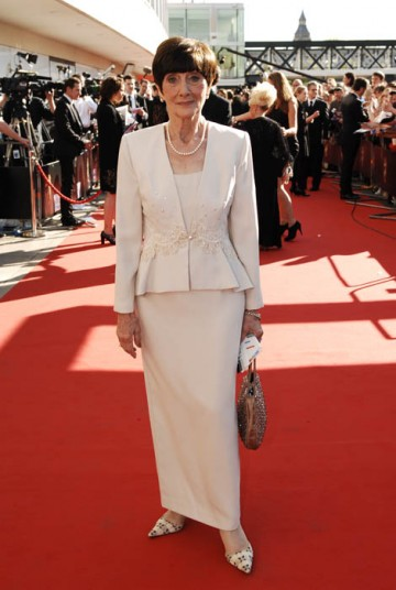 This cream coloured dress and matching jacket is incredibly sophisticated. June is the perfect example of a lady who dresses elegantly for her age. The flare at the bottom of the jacket gives the illusion of hips to June's slim figure, and the tailored