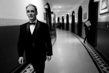 Sir Mark Rylance walks to the stage