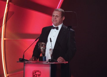 English Actor Nigel Lindsay, perhaps best known for playing the part of Barry in the film Four Lions, presents the Editing: Factual Award. (Pic: BAFTA/Jamie Simonds)