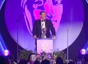 Actor, Adrian Dunbar presents the Special Award to Colourist, Aidan Farrell.