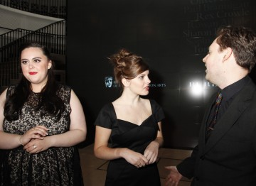 Sharon Rooney looks on while Sophia George and Oliver Clarke converse.