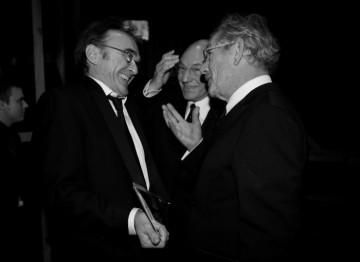 Sir Ian McKellen and Sir Patrick Stewart congratulate Danny Boyle after presenting him with the Best Director BAFTA for Slumdog Millionaire (Greg Williams / Art+Commerce).