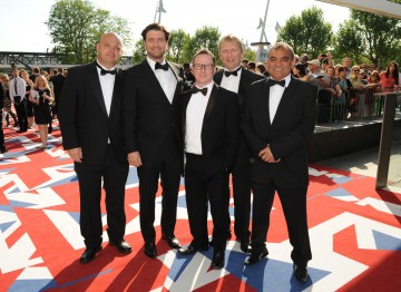 The team behind DIY SOS: The Big Build, including presenter Nick Knowles, which is nominated in the Features category. Nick wears a suit designed by Ozwald Boateng.