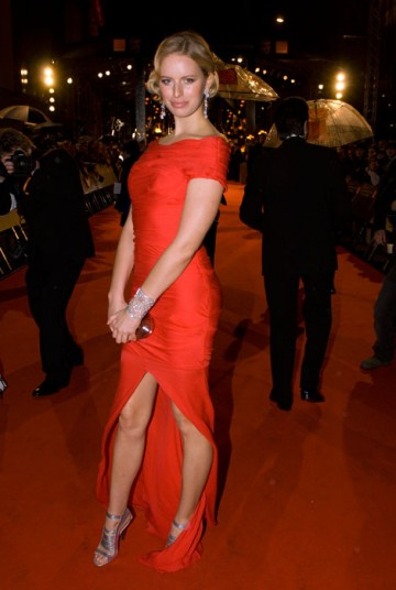 The super model wowed onlookers with a striking red gown combined with subtle 1950s style hair (BAFTA / Richard Kendal).