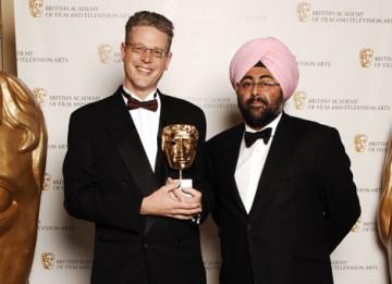 Joby Gee celebrates his Editing Factual win for The Fallen with comedian Hardeep Singh Kohli (BAFTA / Richard Kendal).