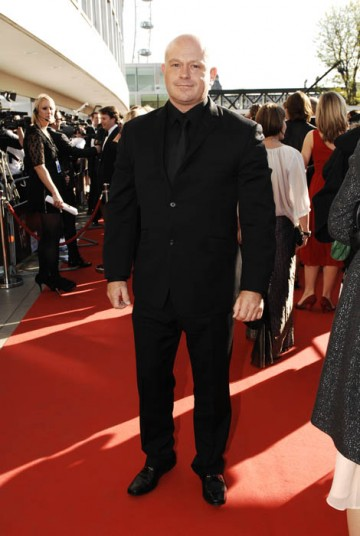 Double-BAFTA nominee Ross Kemp changed from his army combats to look dashing in an all-black Alexander McQueen suit (BAFTA / Richard Kendal).