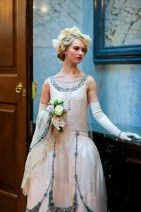 Lily James pictured as Lady Rose MacClare in the gown created by Downton Abbey's costume department for her debutante presentation.