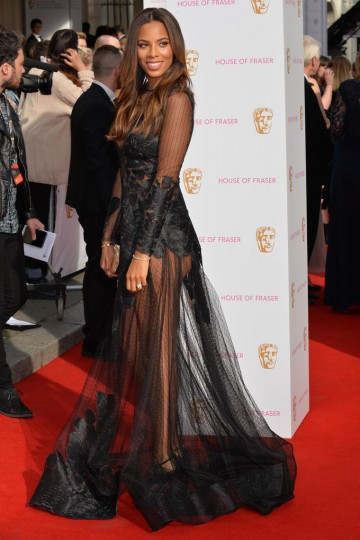Rochelle Humes arrives on the red carpet. Clutch bag by House of Fraser