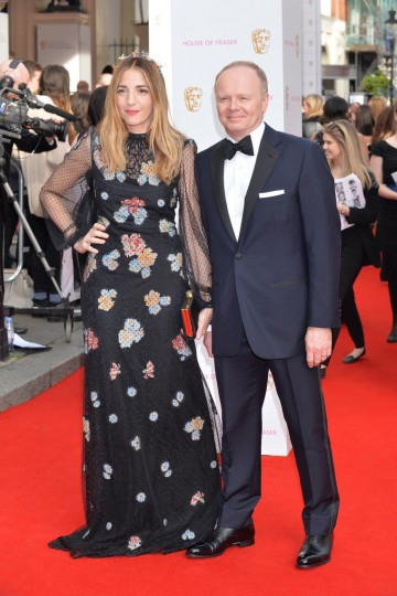 Jason Watkins, nominee in the Leading Actor category, and guest arrive on the red carpet