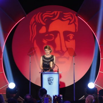 Caroline McCall accepts the award for Costume Design for her work on Downton Abbey at the British Academy Television Craft Awards in 2014. The show has been nominated for 14 BAFTAs, winning three times.