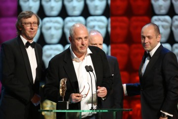 Gareth Neame, Peter Morgan, Roger Michell and Kevin Loader accept the award for Mini Series