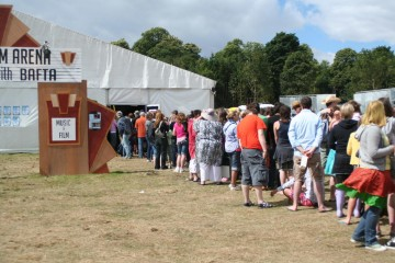 Festival Goers queue on Sunday morning to watch Angus, Thongs and Perfect Snogging