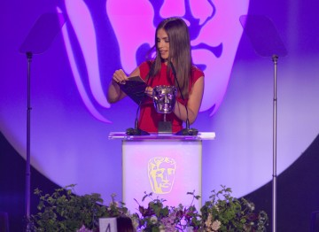 Actress Charlotte Riley presents the BAFTA for Costume Design.