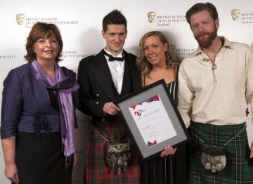 Winner for Entertainment: The State of Greenock, Gavin Grant, Pamela Barnes and David Newman, presented by Fiona Hyslop MSP, Cabinet Secretary for Culture and External Affairs