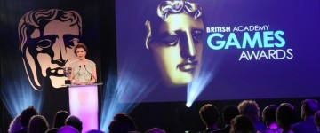 Jo Twist presents the award for Debut Game at the British Academy Games Awards in 2015