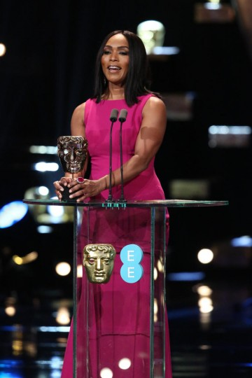 Angela Bassett presents the award for Adapted Screenplay at the 2016 EE British Academy Film Awards