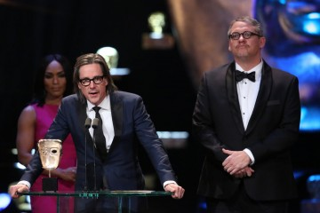 The team for The Big Short collect the award for Adapted Screenplay at the 2016 EE British Academy Film Awards