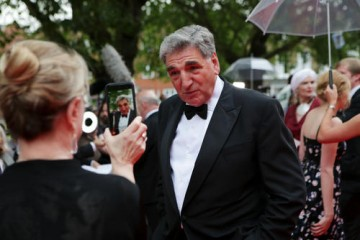 Jim Carter poses for a fan photograph.