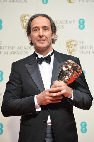 Alexandre Desplat with his award for Original Music in The Grand Budapest Hotel