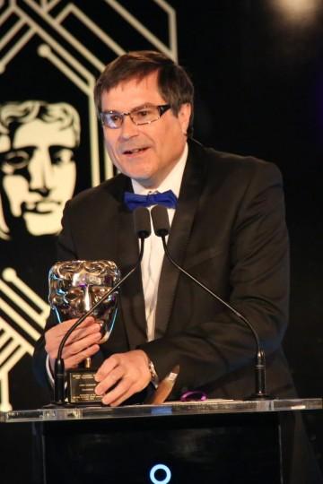 Last year's Fellowship recipient David Braben OBE presents this year's award to John Camack