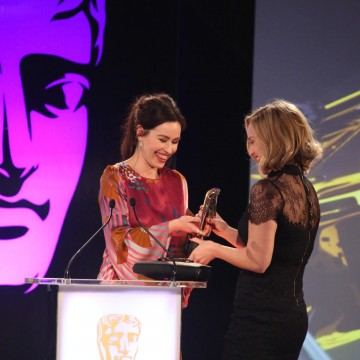 Maime McCoy presents the award for Performer to Ashley Johnson at the British Academy Games Awards in 2015