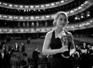 Kate Winslet, winner of Leading Actress BAFTA, shows off her mask in the Main Auditorium of the Royal Opera House (Greg Williams / Art+Commerce).