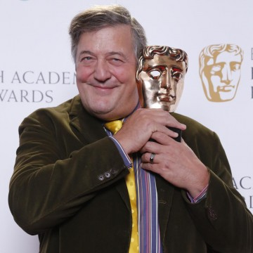 Stephen Fry poses for photos after announcing the nominations for the EE British Academy Film Awards in 2015
